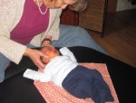 an infant receives a baby check: one weekold